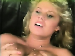 Traci Lords sucks fucked and gets cum on her tits.